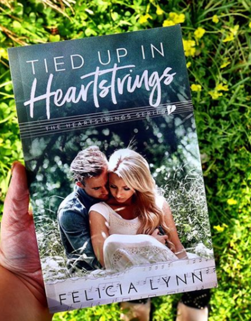 Tied Up in Heartstrings by F. Lynn