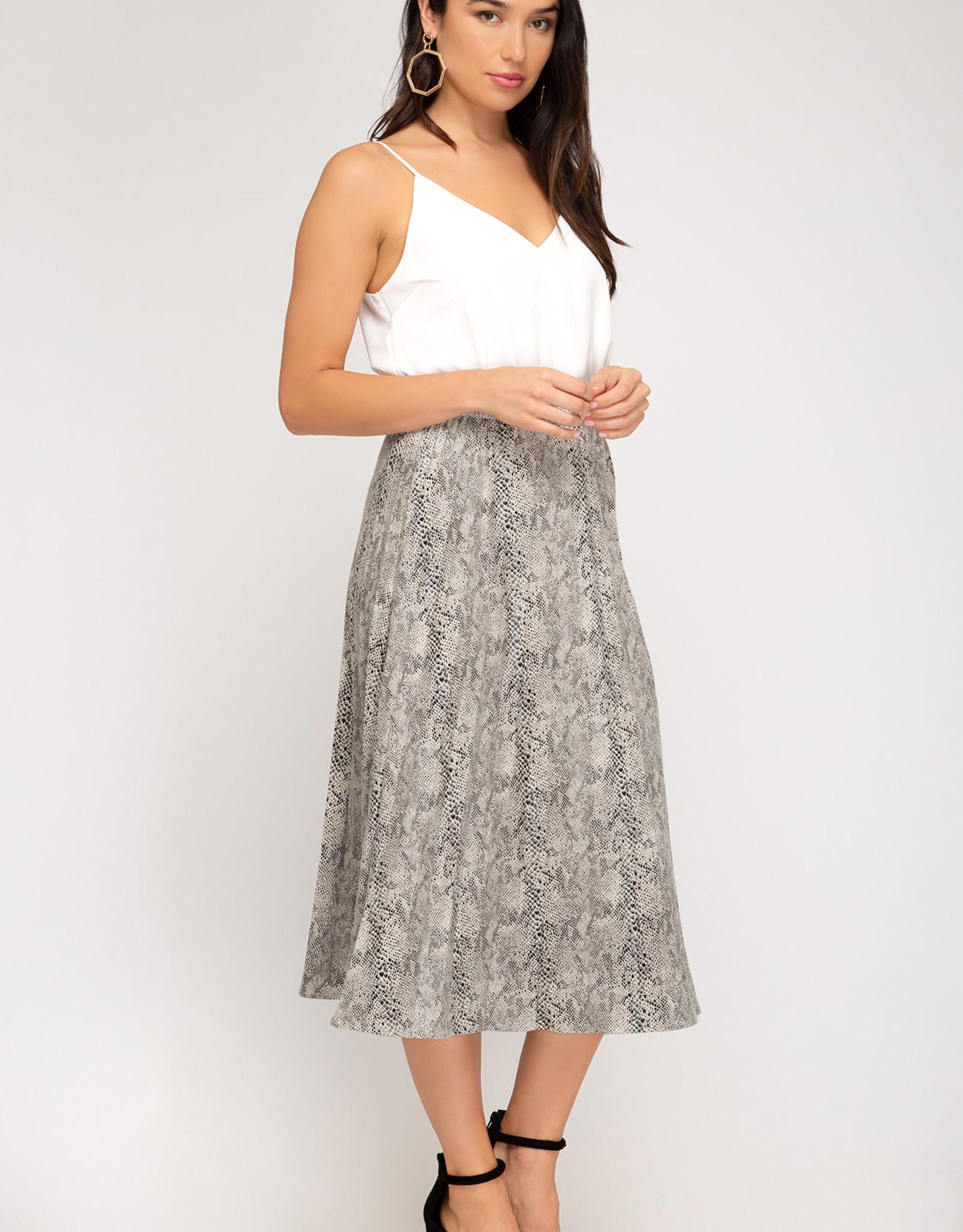 LeBLANC finds PLEATED SNAKE skirt