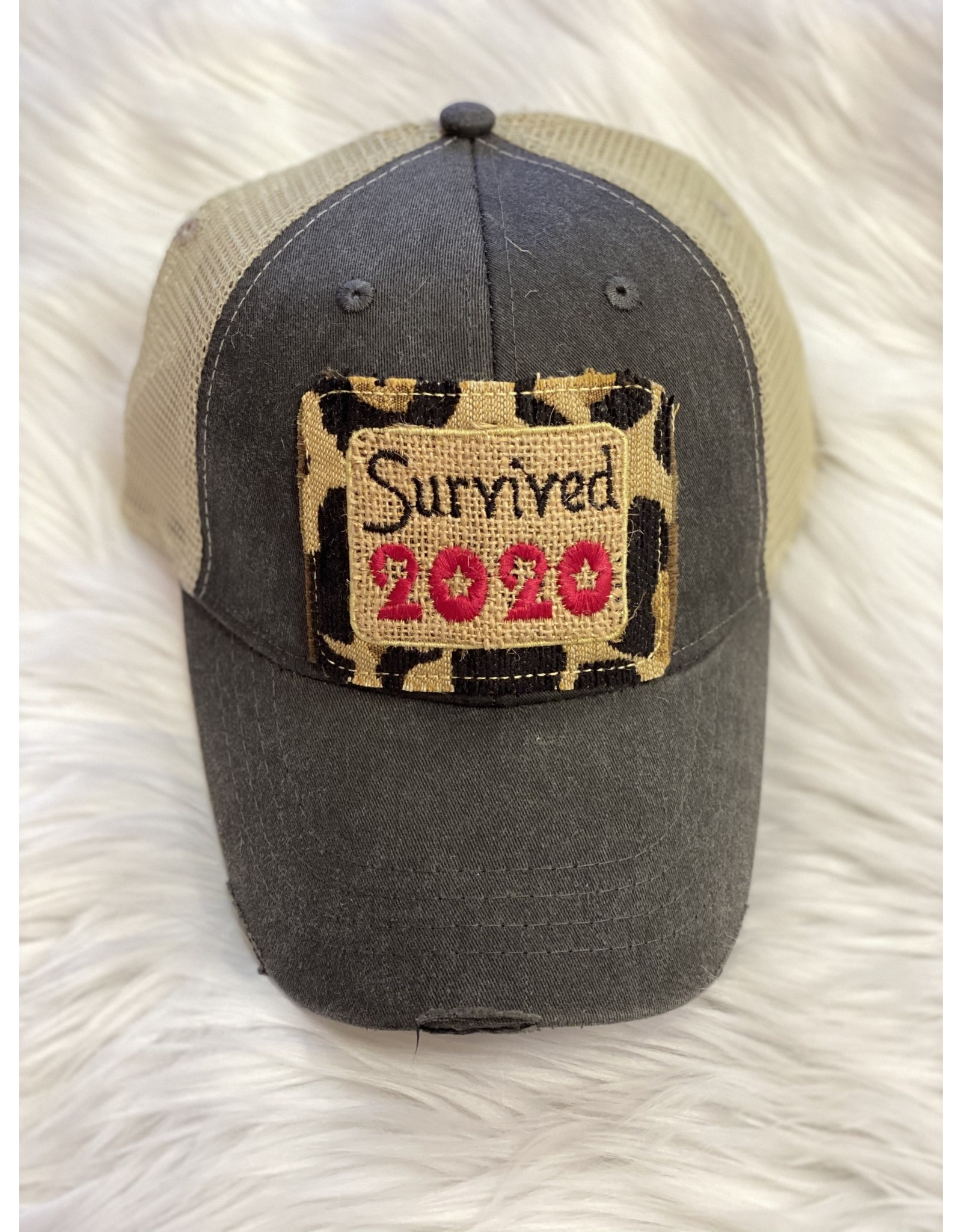 Buck Wholesale SURVIVED 2020 Trucker Hat with Leopard Patch