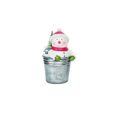 Bonhomme de neige dans sceau avec sapin
