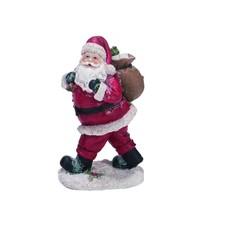 Père Noël marchant avec sac sur le dos