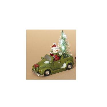 Père Noël en voiture lumineuse verte