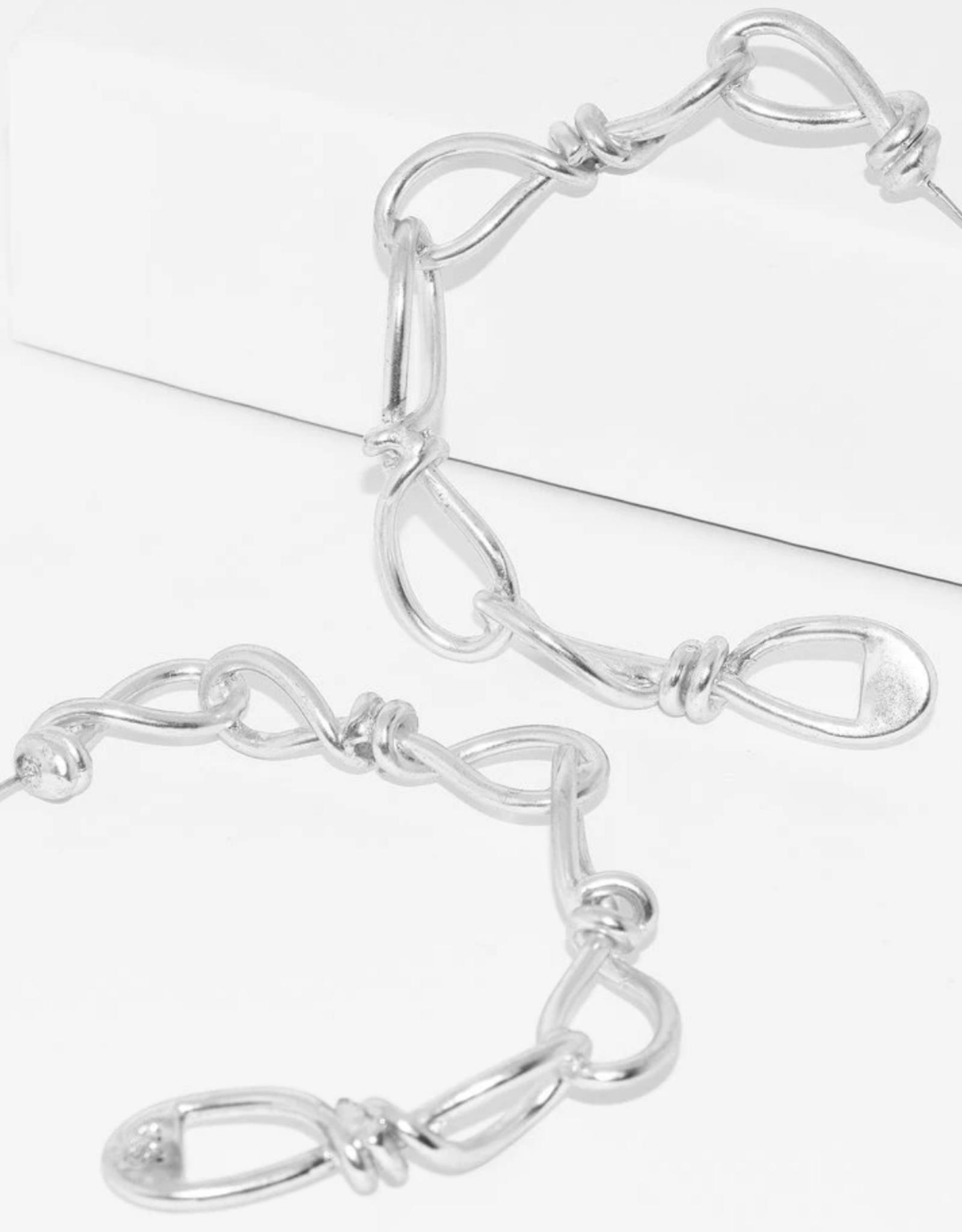 Karine Sultan Large Twisted Link Hoop Earrings 24 kt gold plated pewter.