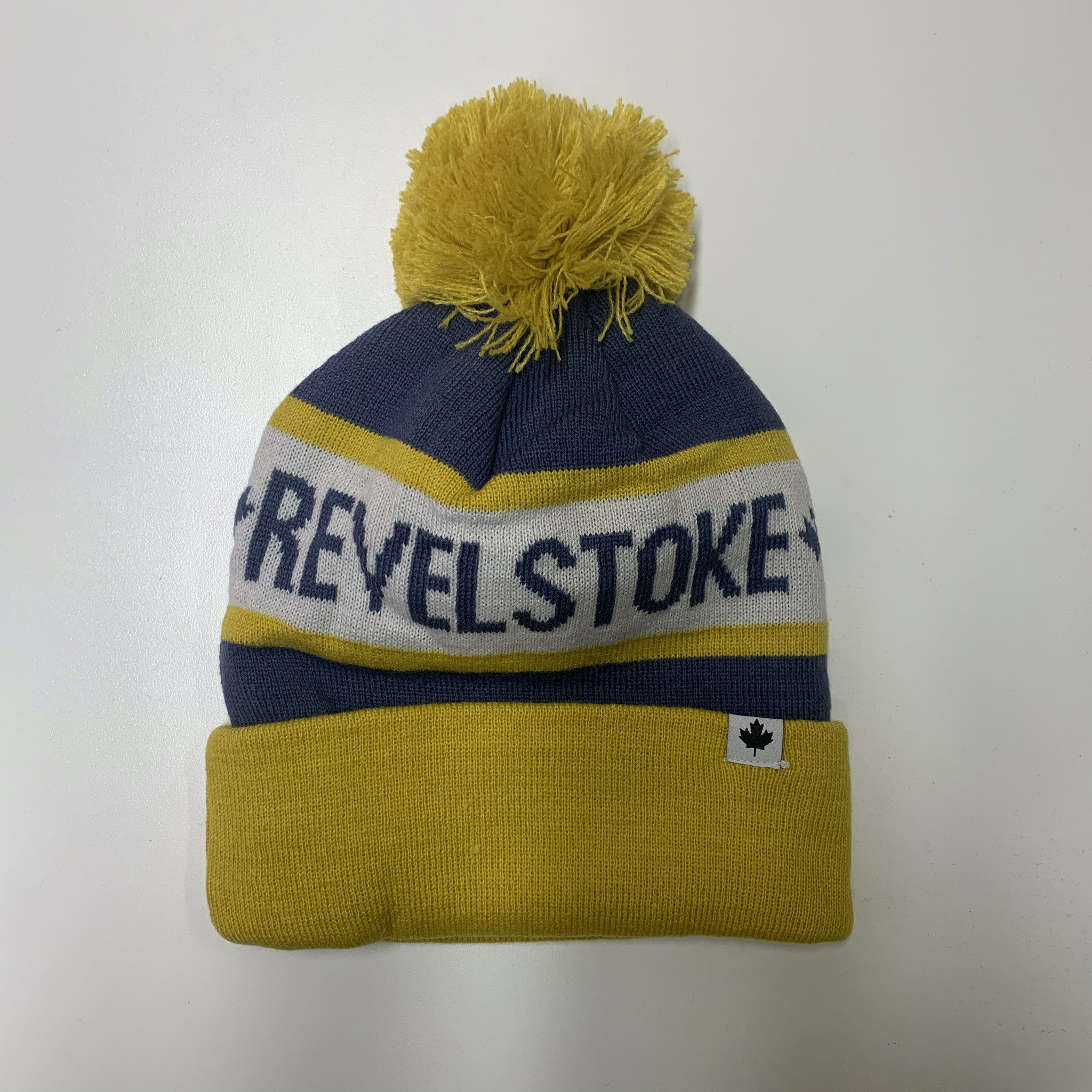 Revelstoke Trading Post Revelstoke - Pom Pom Yellow/Blue