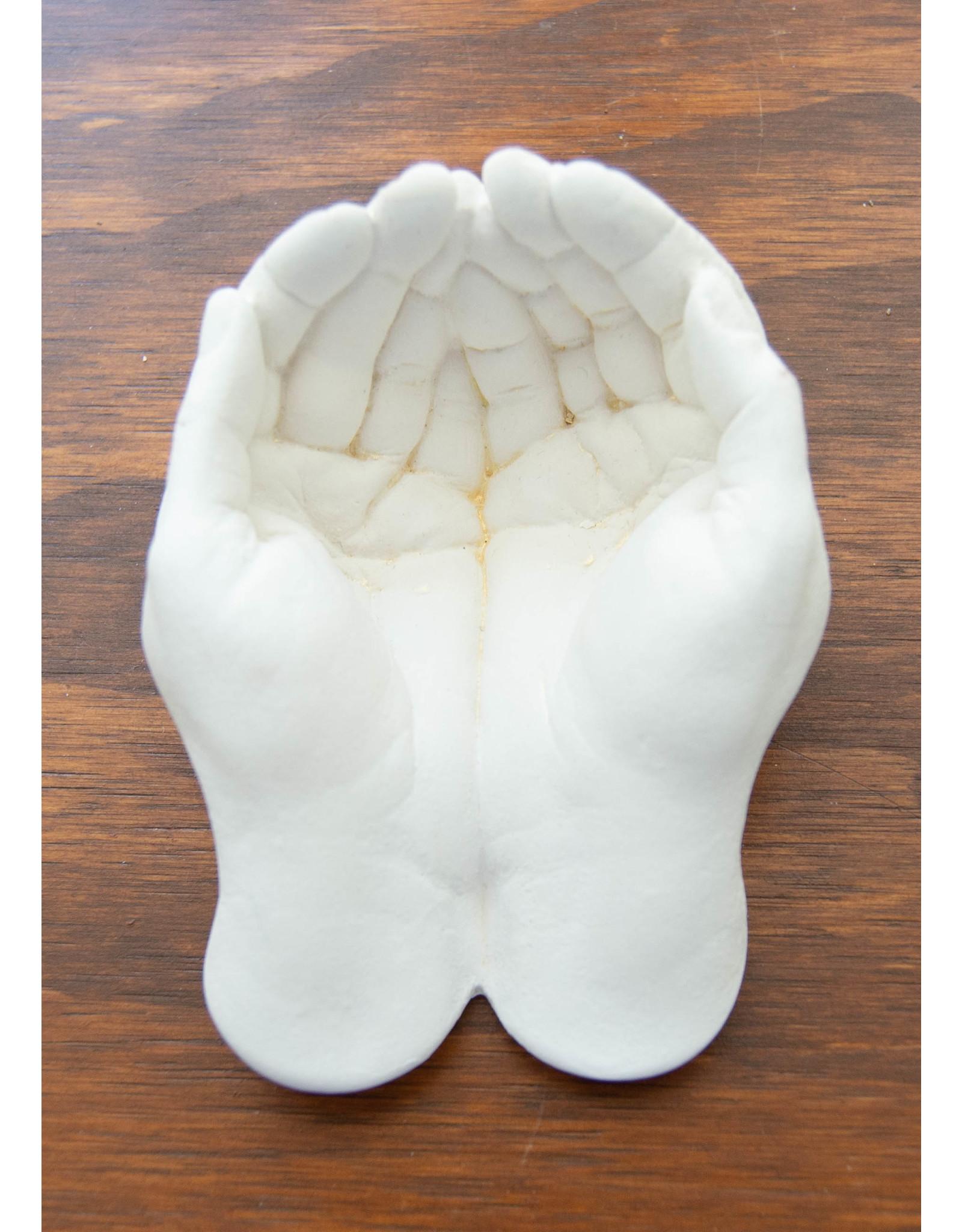 Mains en plâtre