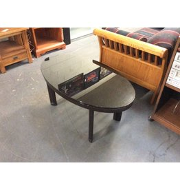 Coffee table / black glass oval