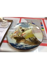 Decor plate ship in ocean with red crosses on sails