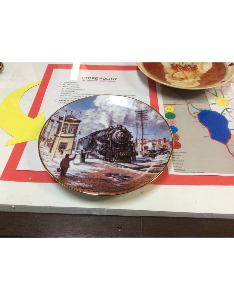 Decor plate train with man waving and cars at crossing