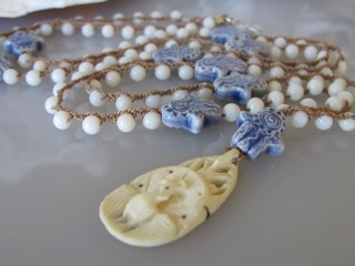 "MiNei Designs 36""  Coral Beads with Artisan Ceramic Hamsa and Carved Peacock Pendant"