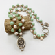 "MiNei Designs #2379 - 18"" Vintage Green Milkglass and Luhuanus Shell Beads w/ Sterling Sun Valley Sun Pendant"