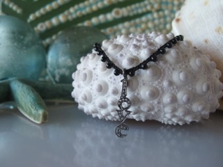 "MiNei Designs Necklace #1878: Black Onyx Beads with Sterling White Topaz ""LOVE"" Charm"