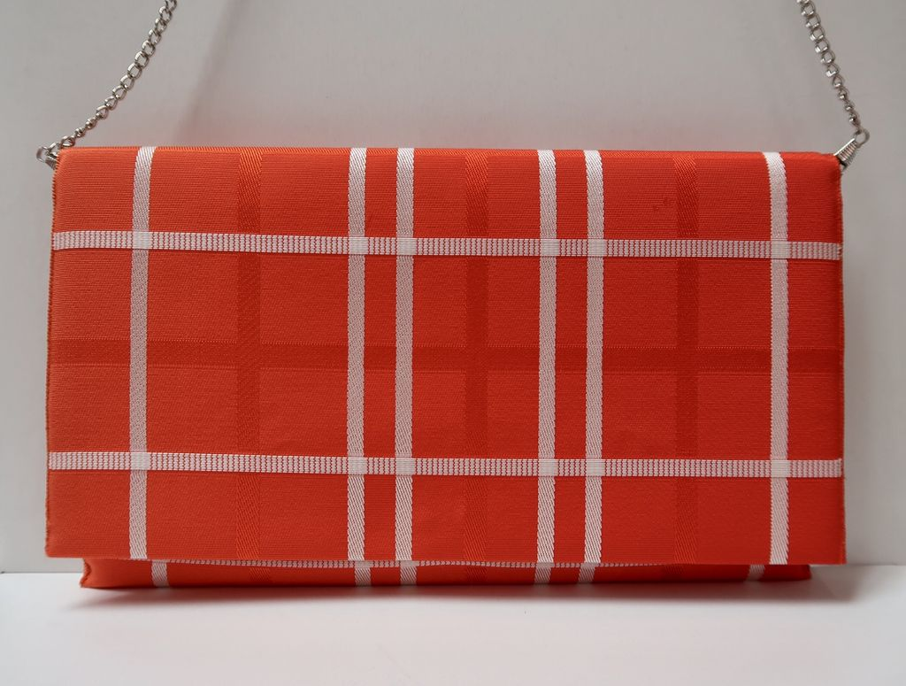 Leina Aonuma ORANGE/WHITE CRISS CROSS: OBI CLUTCH