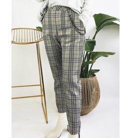Pantalon taille haute à motif plaid et détail chaine