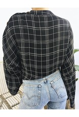 Checkered blouse with knotted detail and buttons