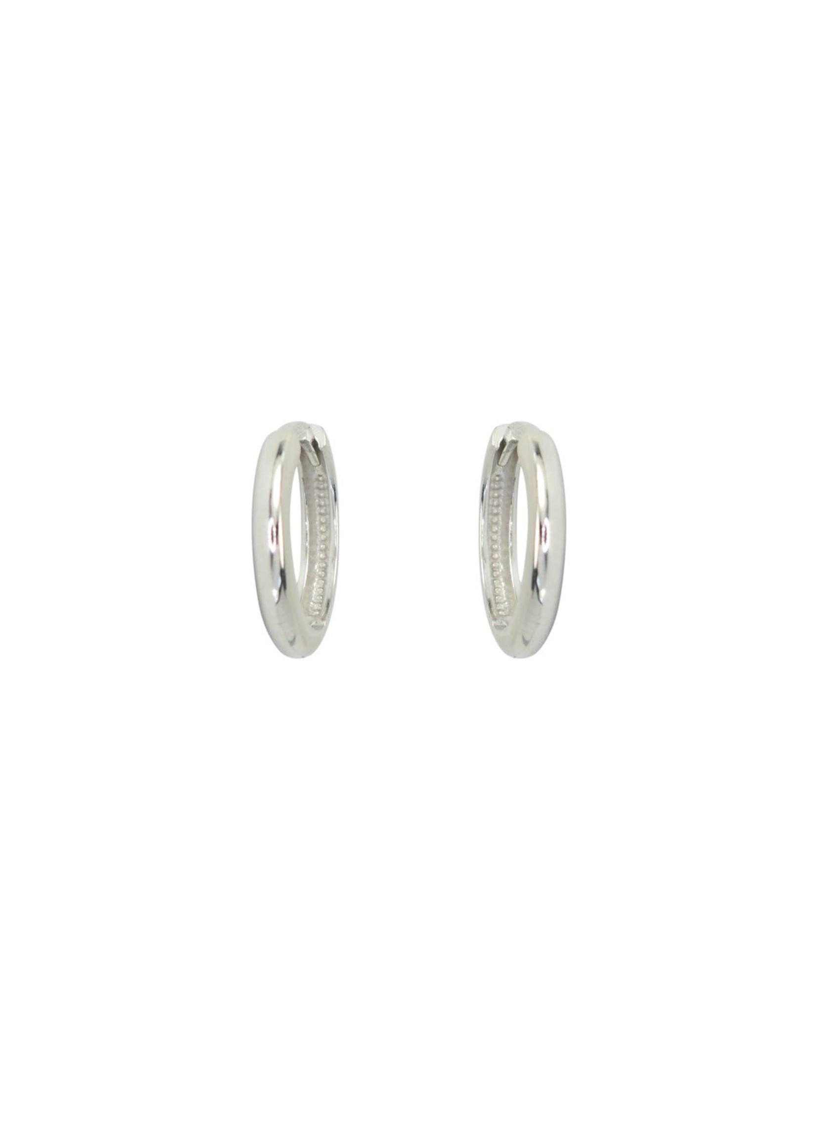 PARÉ Boucles d'oreilles Huggies Or blanc 10K
