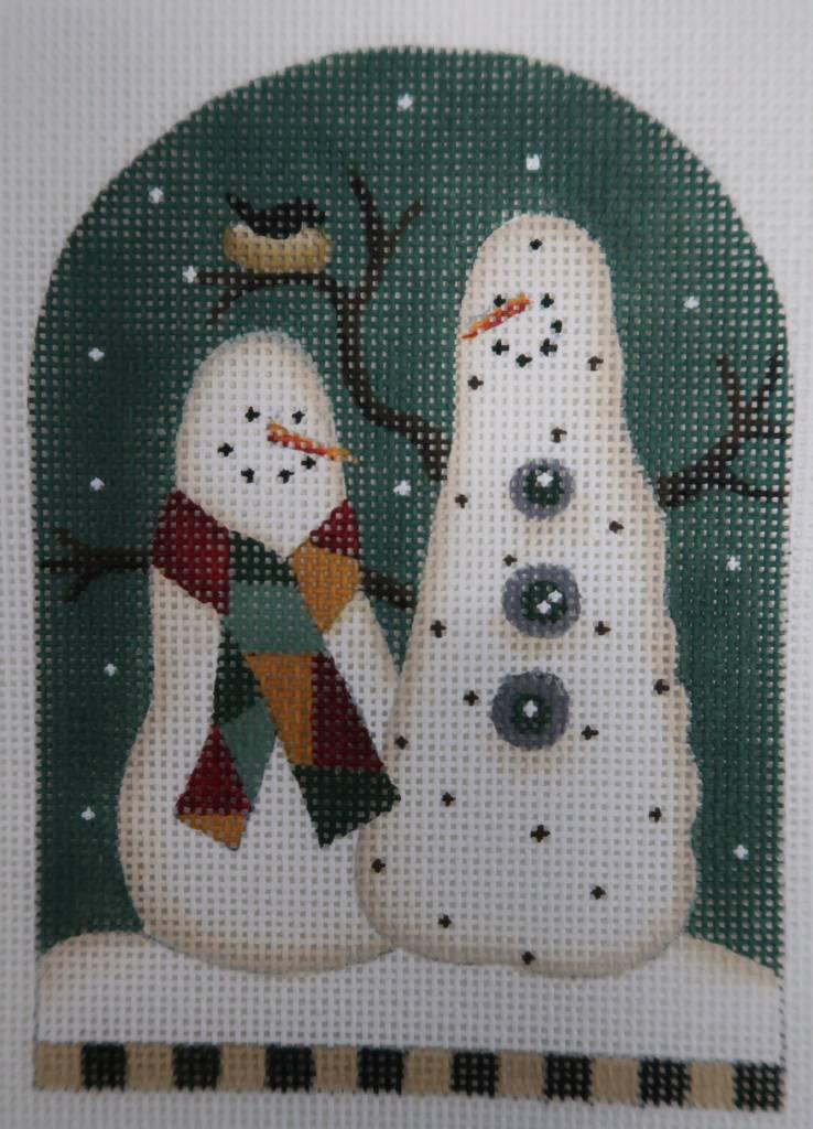 Snowmen with bird nest