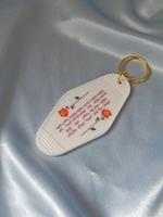 A SHOP OF THINGS FOREVER ALONE MOTEL KEYCHAIN