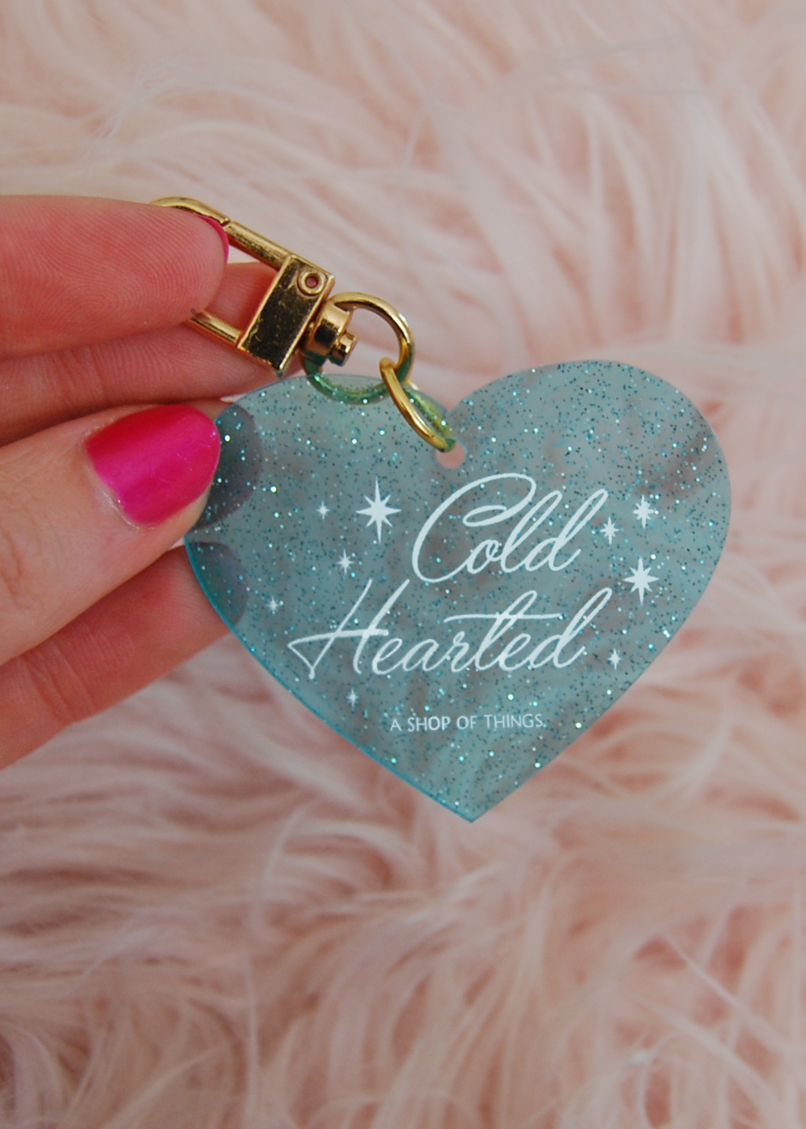 A SHOP OF THINGS COLD HEARTED GLITTER KEYCHAIN