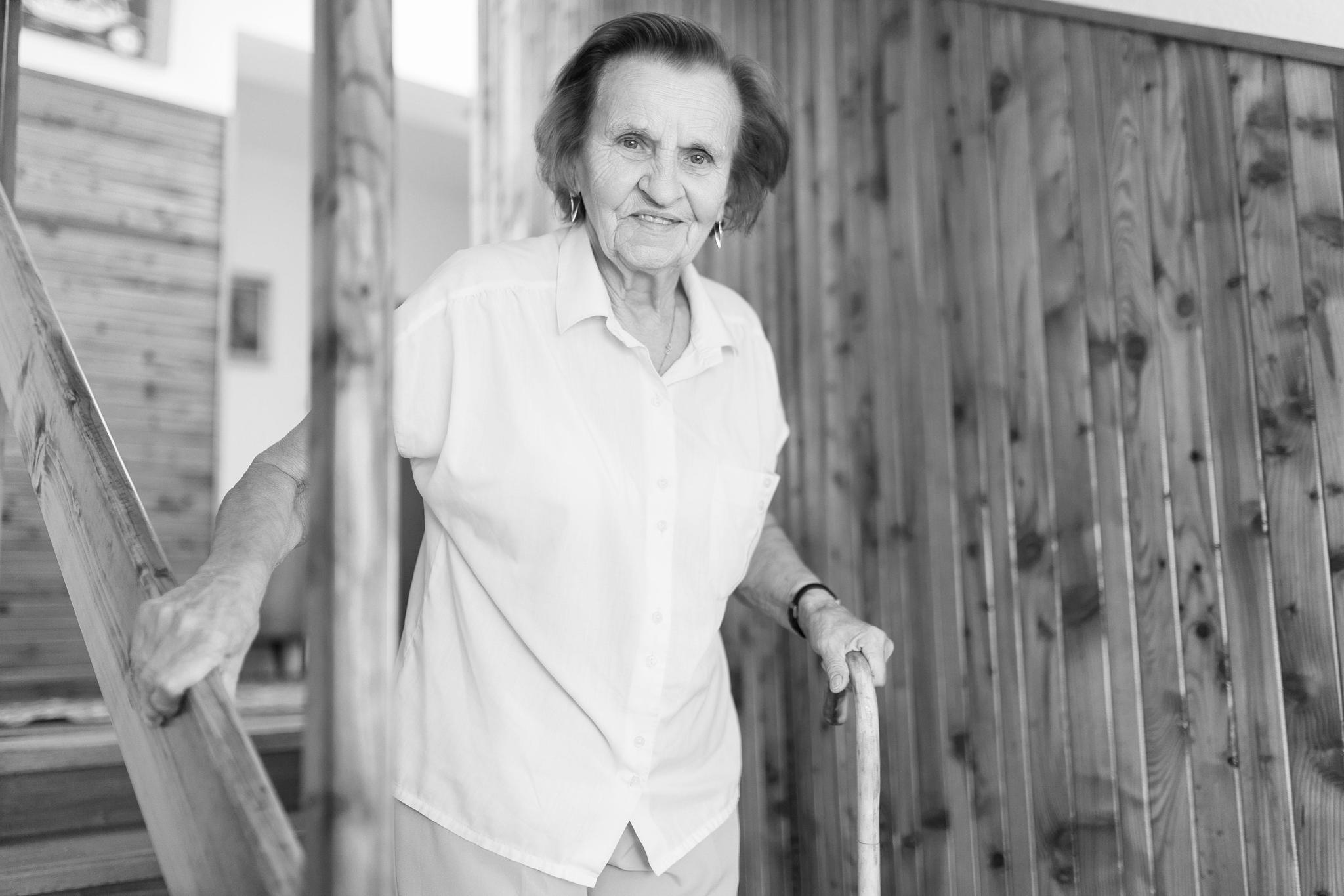 Senior Woman Holding Railing On Stairs At Home
