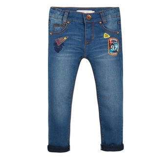 SLIM STONE-WASHED DENIMS WITH BADGES