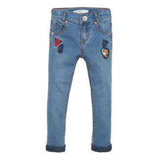 Bleached slim jeans with badges