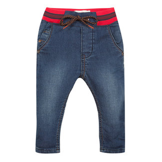 Stone-washed denim blue knit jeans with an elasticated waist