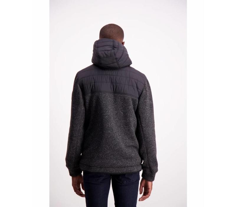 Quilted jacket with knit sleeves