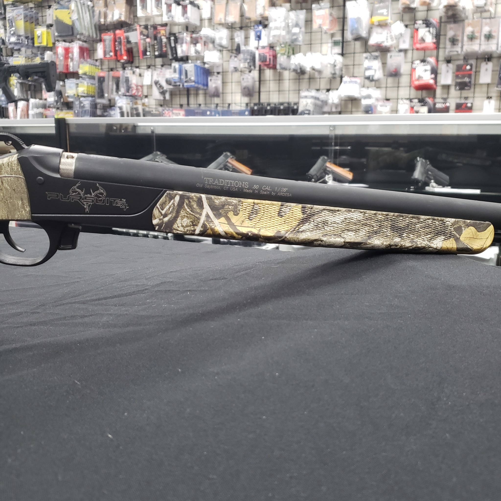 "Traditions Pursuit G4 Ultralight Rifle  Realtree Edge Camo - No Sights/.50 cal / 26"" Nitride/42""/5"