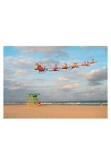 Card BX XMAS Santa in Sleigh Flying Over Beach