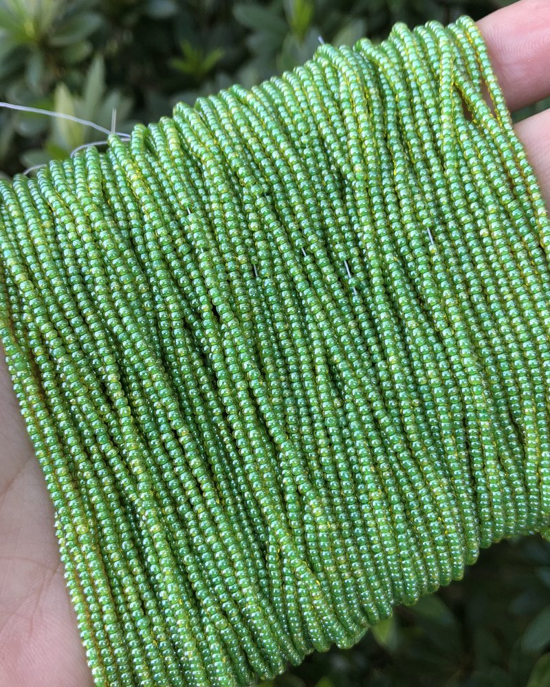 11/0 #744 Citrine Green Lined