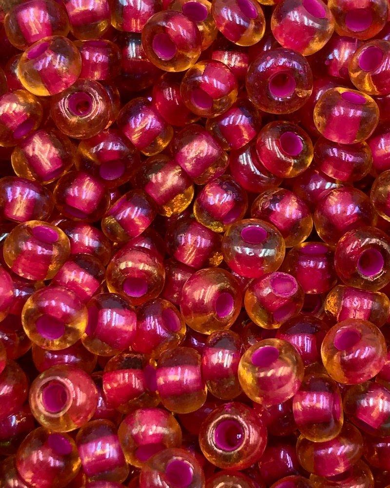 SIZE 6/0 #1100 Topaz Light Pink Lined Rainbow