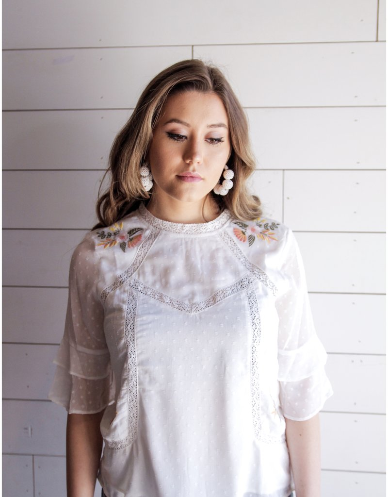 Embroidered Ruffle Ell Top