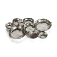 Cluster of Nine Nickel Serving Bowls
