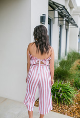Striped jumpsuit with front ruffle