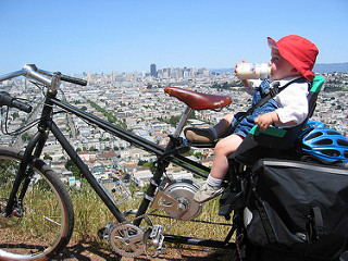 A child on an Xtracycle cargo bike