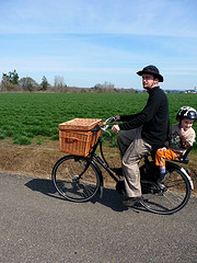 A WorkCycles cargo bike with a wicker front basket