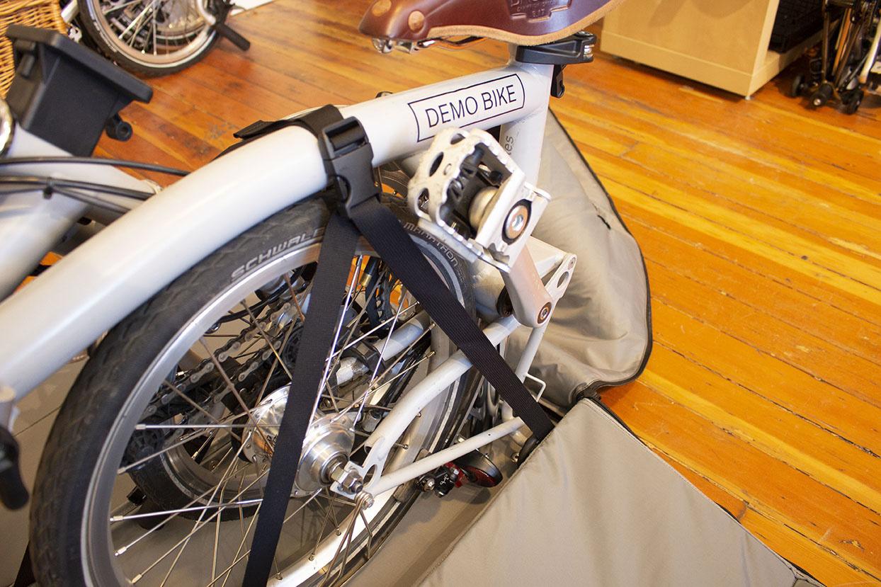 Brompton folding bike strapped into Brompton Travel Bag