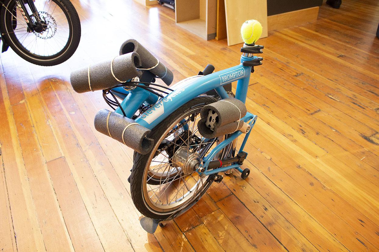 A Brompton folding bike ready for gate check