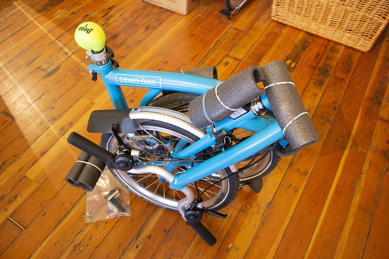 A Brompton folding bike prepared for airport gate check