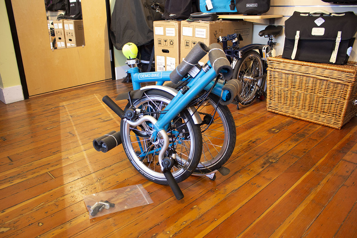 A Brompton folding bike ready for airport gate check