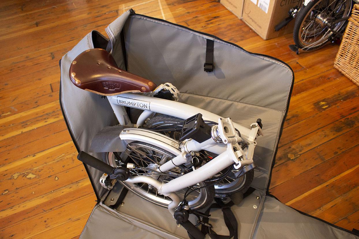 Brompton Travel Bag, unzipped, with bike in it
