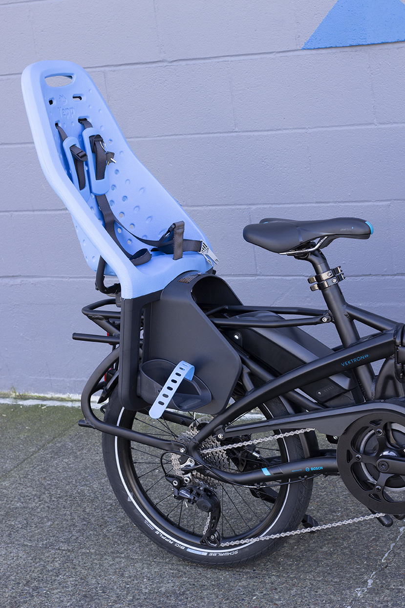A Tern Vektron folding bike with a child seat attached