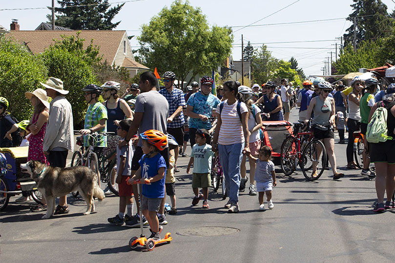 Crowd of people in the street at Sunday Parkways in North Portland