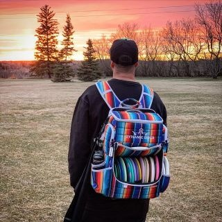 Person wearing a disc golf backpack