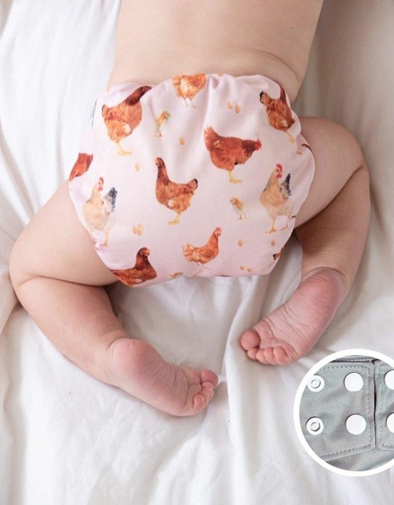 La petite Ourse Couche à poche snap poulette