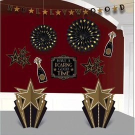 """Hollywood Glitz & Glam Decorating Kit         Contains: 1 Garland, 10' 2 Printed            Contains: 1 Garland, 10' 2 Printed Paper Fan Decorations, 12"""" 4 Printed Paper Decorations, 10"""" 1 Printed Paper Cutout Sign, 14"""" 2 3-D"""