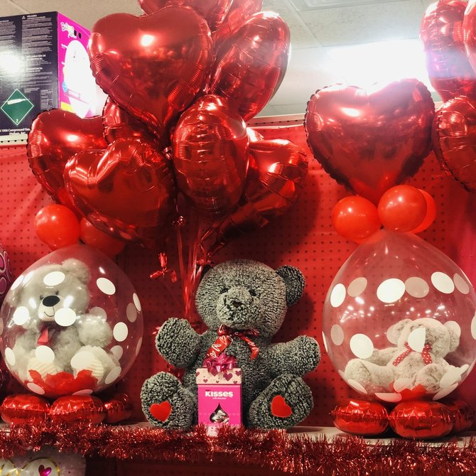 X-Large Bear w/ Red heart foil bouquet and box of Hershey Kisses.