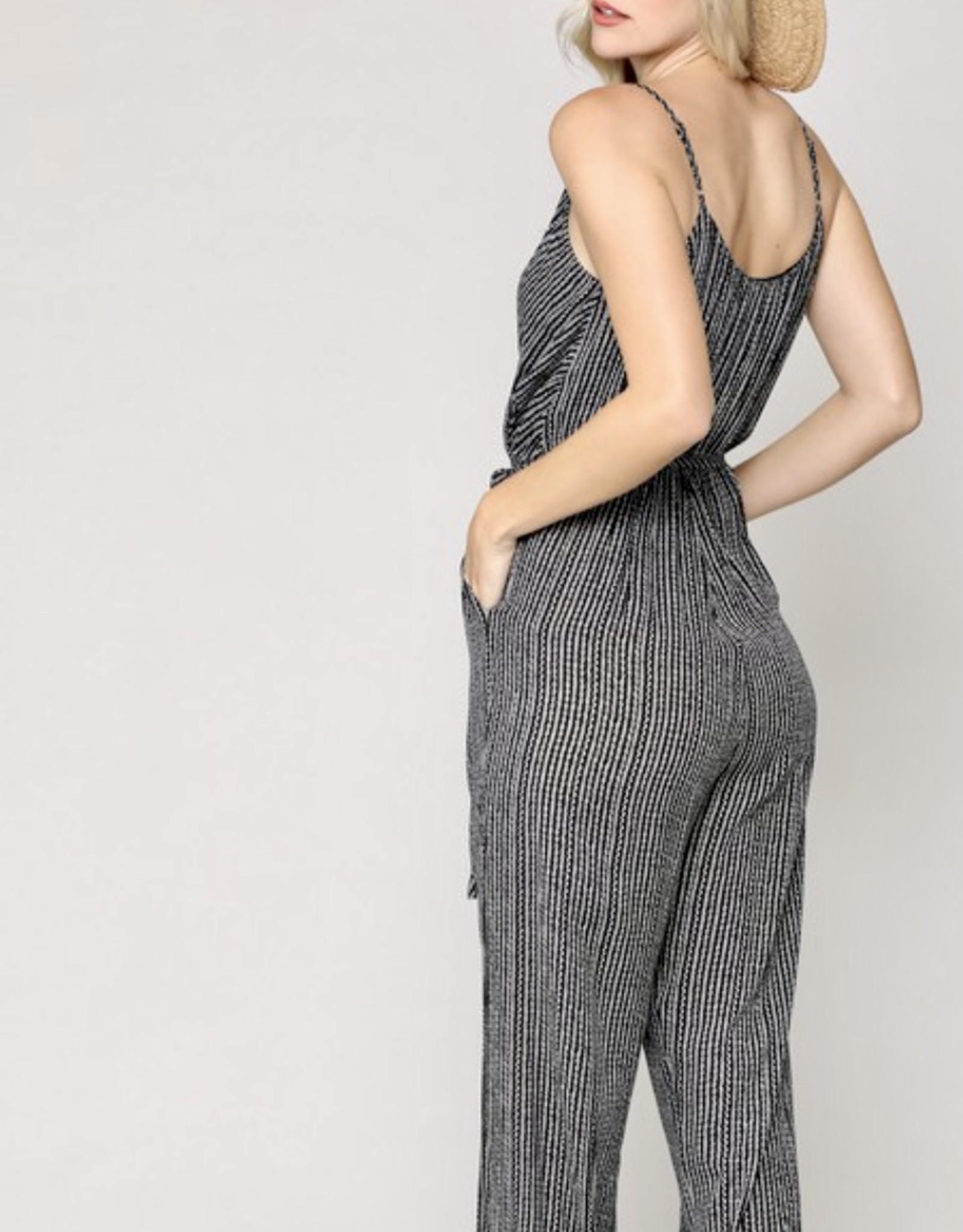 HUSH Deep v printed jumpsuit w/ open leg slit