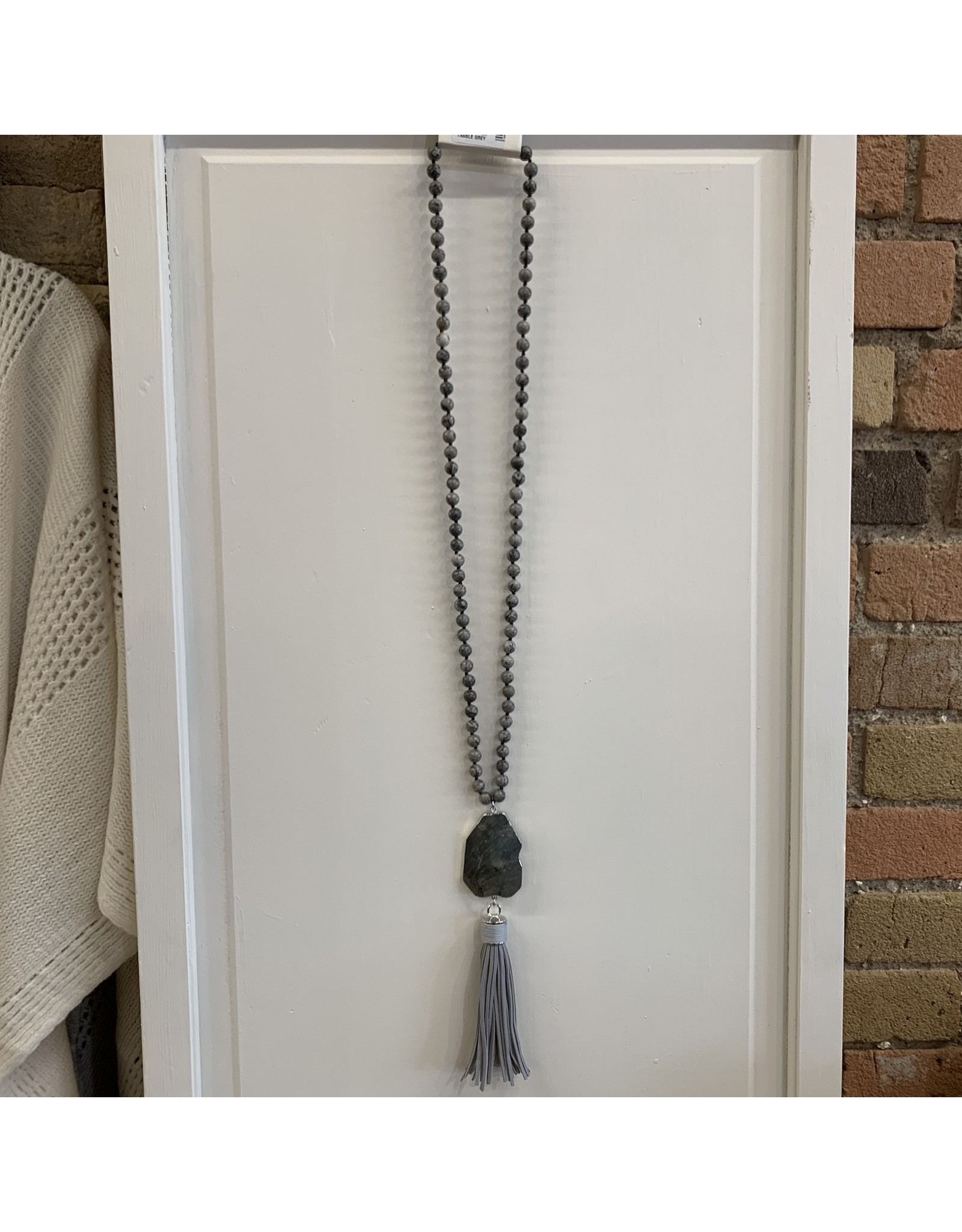 BEADED NECKLACE WITH STONE PENDANT AND LEATHER TASSLE