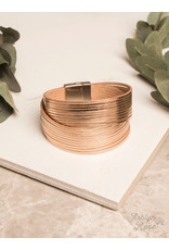 MAGNETIC BRACELET CROSSING PATHS ROSE GOLD